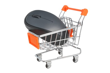 Computer mouse in supermarket pushcart isolated on white background photo
