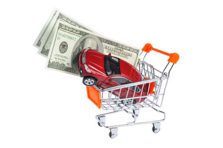 Toy car with money in shopping cart isolated on white background photo