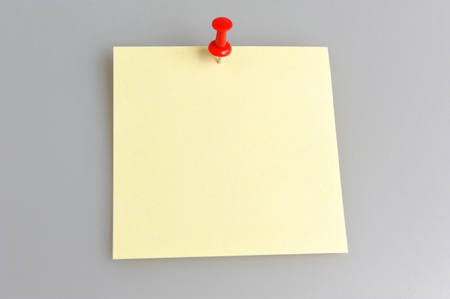 one sheet: One yellow paper sheet attached with red office button on gray background