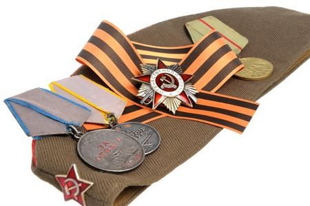 Soviet military cap with Saint George ribbon and medals of Great Patriotic war isolated photo