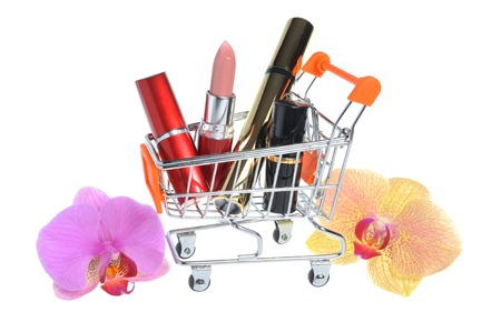 pushcart: Makeup in pushcart with orchid flowers isolated on white