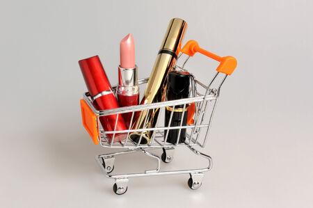 pushcart: Makeup in pushcart on gray background Stock Photo