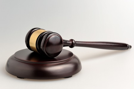 Hammer of judge on gray background