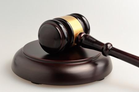 Hammer of judge on gray closeup
