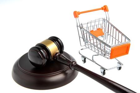 Hammer of judge with pushcart isolated on white background Stock Photo