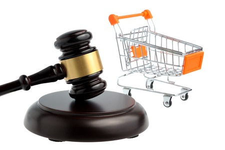 Hammer of judge with pushcart isolated photo