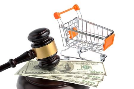 Hammer of judge, pushcart and money isolated on white background photo