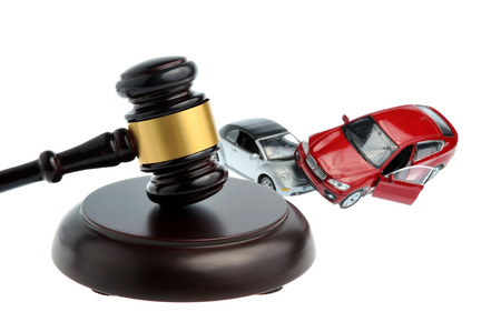 Hammer of judge with models of car accident isolated on white background Stock Photo