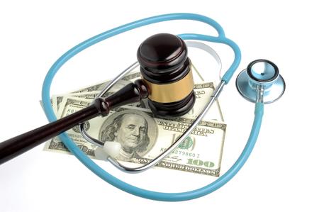 Stethoscope with judge gavel, money isolated on white background Stock Photo