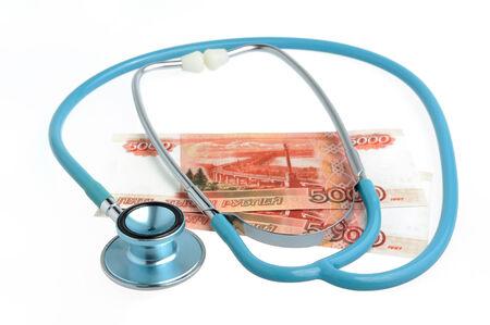 Stethoscope and money isolated on white background photo