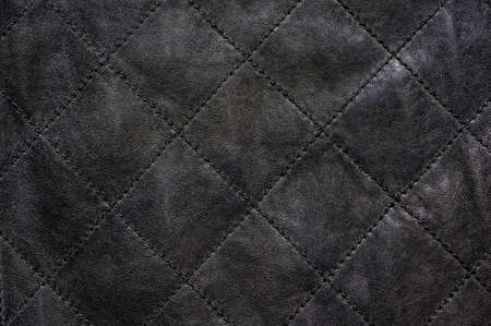 stitched: Gray natural leather stitched diagonally
