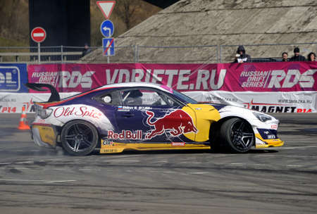 onsite: Moscow, Russia - April 25, 2015: Sports car Rocket Bull 86 performs on-site drift Drift show, side view Editorial