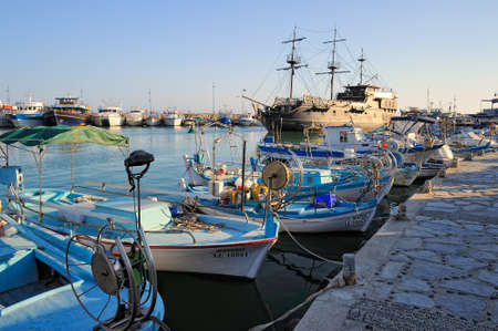 pleasure boat: Pleasure boat a replica of the famous Black Pearl anchored surrounded by fishing boats in the bay of Ayia Napa