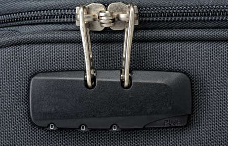 combination: Combination lock for zipper on a suitcase