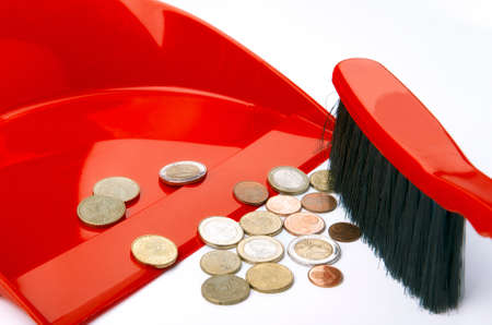 cleaning debt: Dustpan, brush and eurocent Stock Photo