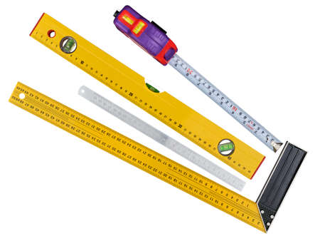 Used rulers and tape measure isolated on white background