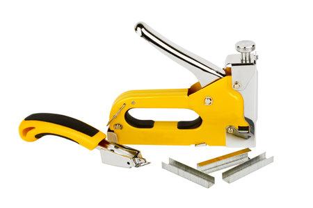 Stapler for furniture, staples, staple remover, isolated on white background Foto de archivo