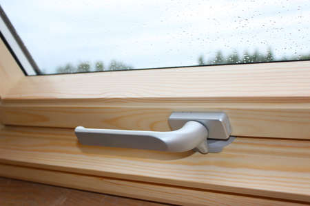 A Modern Sunroof. Handle for opening the attic window, close-up. Mansard Design Of An Attic House. Roofing Construction.