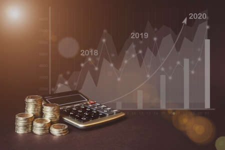 Money coin on each line rising, calculator, virtual hologram of statistics, graph and chart with arrow up on dark background. The economy of trend background for business ideas and all the artwork design