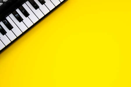 Music Keyboard over yellow background. Copy space