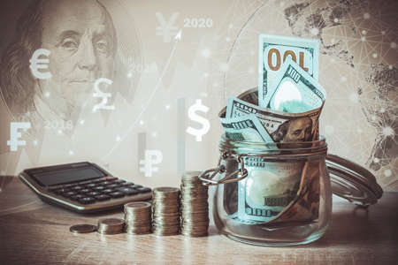 Coins Stack, calculator, dollar bills in glass jar, virtual hologram, earth, stat, graph,currency icons different countries. Savings money,income Investment ideas, management.Business Growth concept Foto de archivo