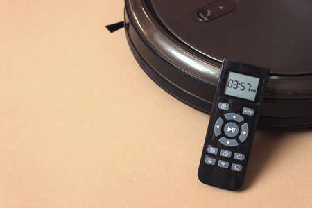 Robot vacuum cleaner automate with Remote Control. clean floor machine. housework and technology concept
