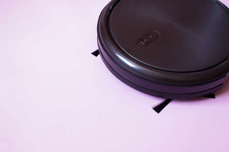 Robot vacuum cleaner performs automatic cleaning. Indoor, housework 写真素材