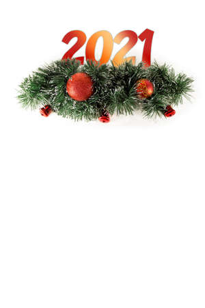 Christmas and 2021 new year composition. Christmas toys on tree garland spruce branches on a white background. Flat layer, top. Copy, greeting. Winter holiday theme. Happy New Year. Space for text