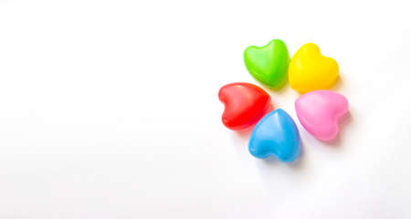 Five multicolored hearts on a white background. Unified Friendship Concept. Love and multi ethnic relationship concept