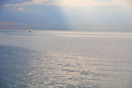 A lonely man and a dolphin in the sea. Sochi, Russia