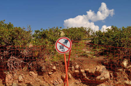 Sign prohibiting tear mountain plants Rhododendron, Sochi, Russia Фото со стока
