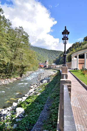 View of the embankment of the river Mtsesta, Krasnaya Polyana, Sochi, Russia. Фото со стока