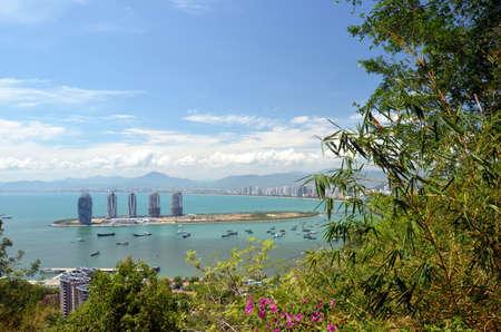 China Hainan island, city of Sanya aerial view Фото со стока - 104909261