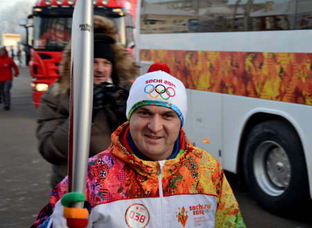 OMSK, RUSSIA - December 9th, 2013: Olympic Torch Relay in Omsk, Russia Редакционное