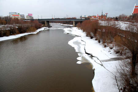 Om River in early spring, the city of Omsk, Siberia, Russia Фото со стока