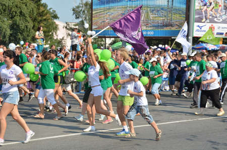 OMSK, RUSSIA - AUGUST 12: Marathon runners in action at the Siberian International Marathon on August 12, 2012 in Omsk.