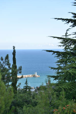 View of the lighthouse of the sea port of Yalta