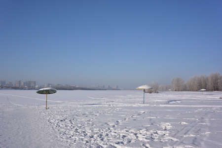View of winter beach on the bank of the Irtysh River, Omsk region, Russia Reklamní fotografie