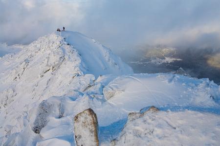Mountaineering. Teamwork in alpinism.  Traverse of mountain. Stock Photo