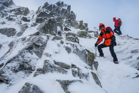 Mountaineering. Teamwork in alpinism.  Traverse of mountain. Stock Photo