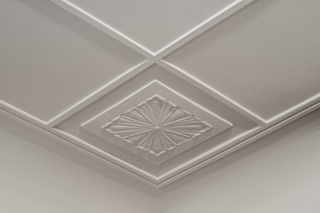 Tracery on white plasterboard. Geometry and flower ornament.