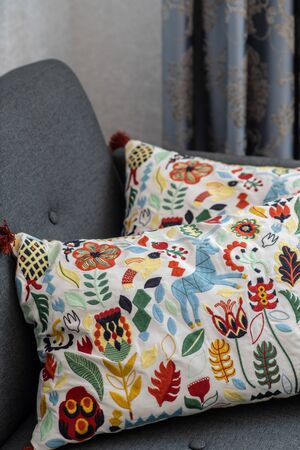Soft decorative pillows on the sofa. Multi-colored embroidery