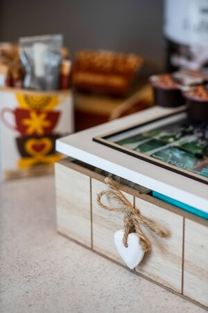 Macroshot of wooden tea box with little wooden heart as decor.