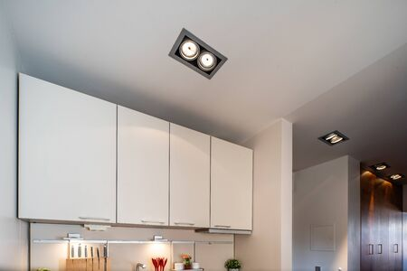 Ceiling in studio apartment. White kitchen. Banco de Imagens - 128816184