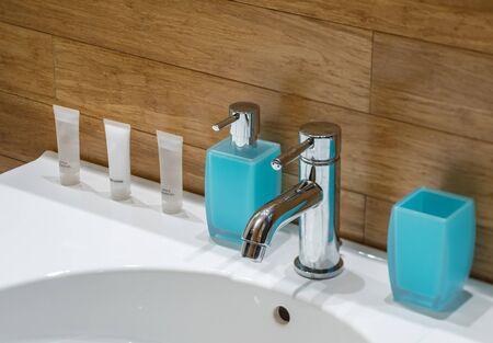 Soap on the sink. Shower gel. Body lotion. Blue glass. Banco de Imagens - 128874425