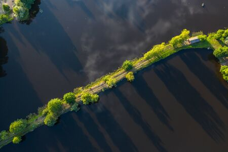 View from above. Green forest. Road through the lake. Banco de Imagens - 129014977