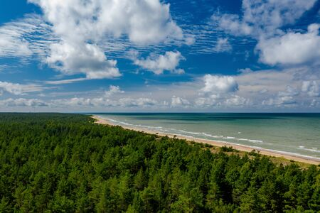 View from above on the sea and forest. Empty seaside. Banco de Imagens - 129015026