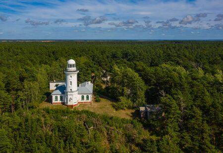 White Uzhava lighthouse. Sunny summer day. Cloudy sky.