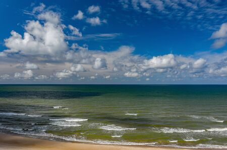 Beautiful view of the sea. Cloudy day. Blue sky. Sand beach. Banco de Imagens - 129015099