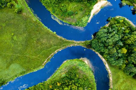 Top view of the beautiful landscape. Green field. Meandering river. Banco de Imagens - 129015267